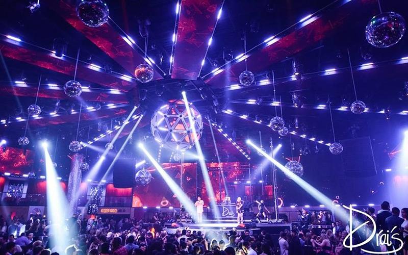 Drai's Las Vegas Nightclub main room crowd and stage view.