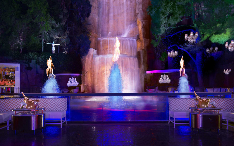 Bottle service at Intrigue Nightclub by the waterfall.